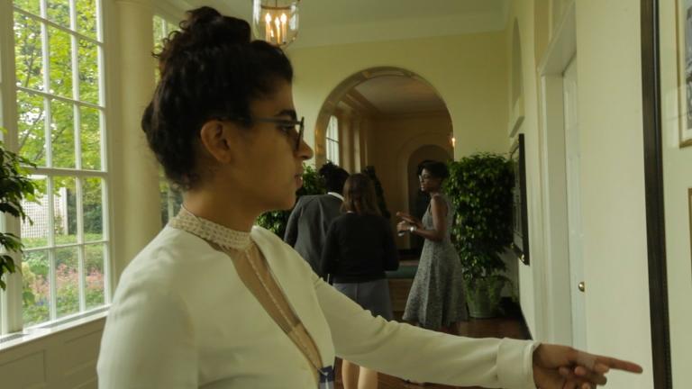 Kiran pointing at walls-5